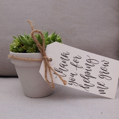 Little painted plant pots tied with string and a thank you for helping me grow tag