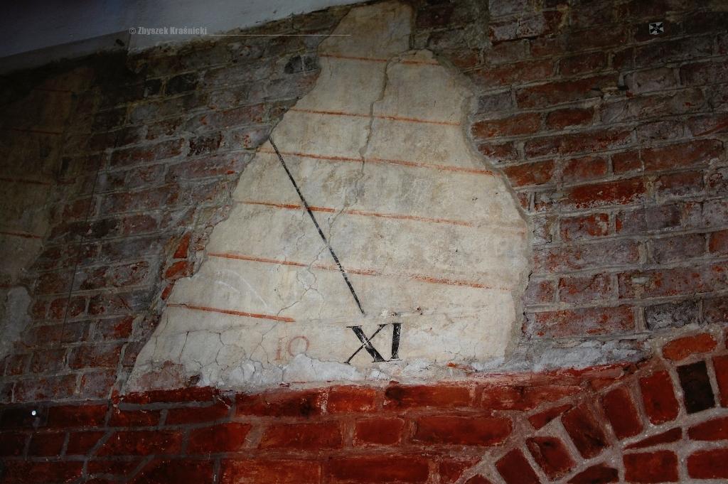 Tablica Kopernika na ścianie olsztyńskiego zamku
