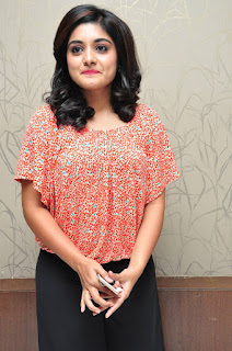Niveda Thomas Sexy Boobs covered in Orange Top and Black Paralel Dark Pink Lipstick
