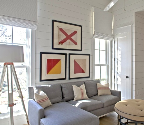 framed nautical flag art above sofa in living room
