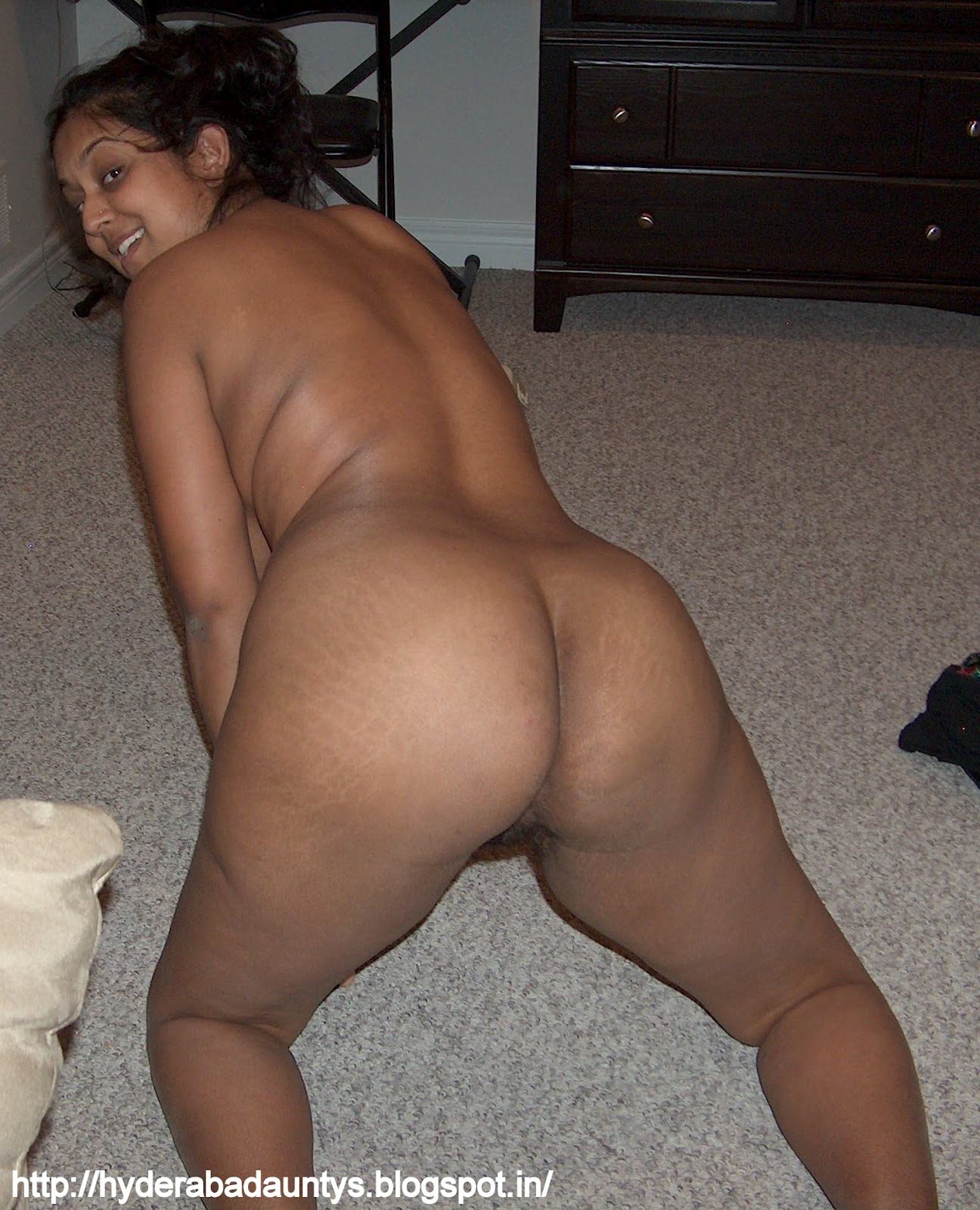 Black woman pussy spread on the bed