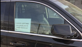 Does placing a 'no valuables inside' sign in a car window deter break-ins?
