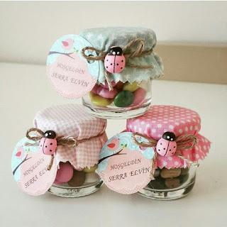 coccinelle e caramelle per bomboniere battesimo