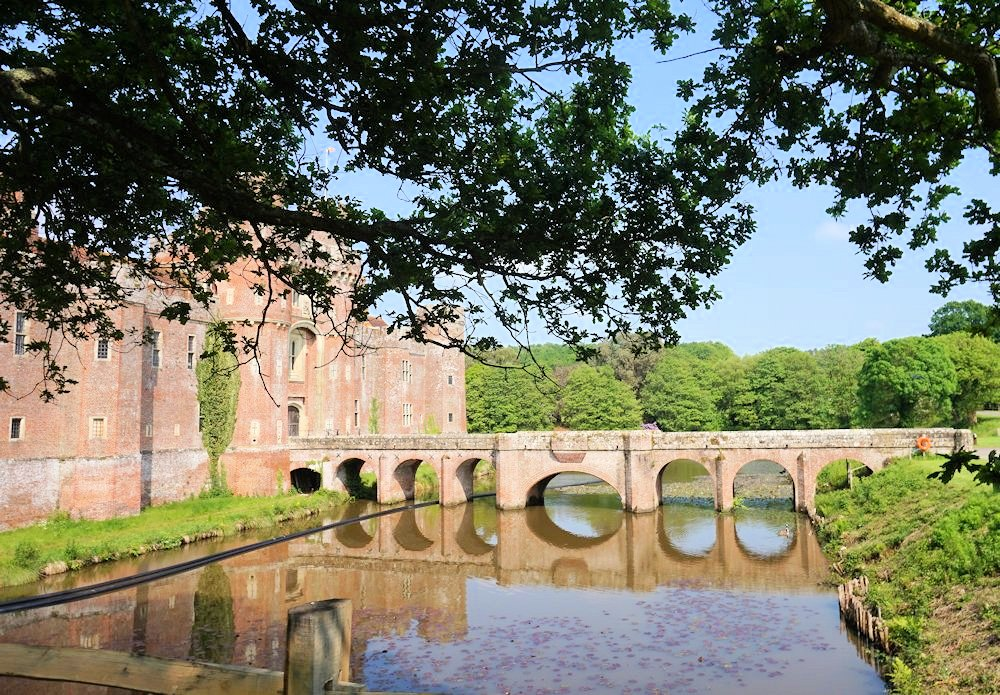 Herstmonceux-Castle-gardens-and-grounds-East-Sussex England history architecture moat reflections