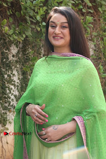 Actress Sonia Agarwal Stills in Green Anarkali Dress at Agalya Tamil Movie Launch  0010.jpg