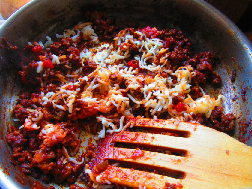 Taco stuffed lumaconi by Laka kuharica: Add Taco seasoning mix, chopped tomatoes and shredded cheese.