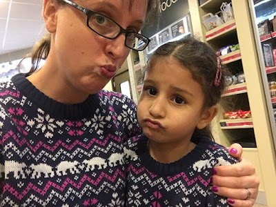 Mum and daughter in matching Christmas jumpers