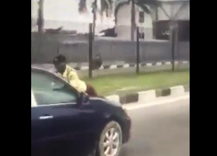 Video: With LASTMA woman on his car bonnet, Lagos driver takes off