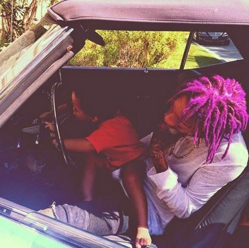 Wiz Kalifa with his son and purple hair