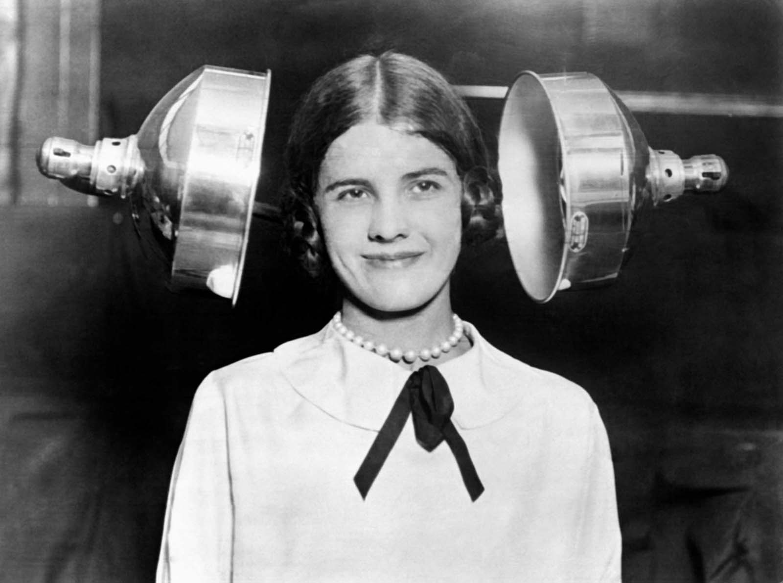New hair dryers have been invented lately to simplify women's lives, circa 1930.