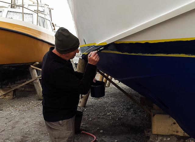 Photo of Phil painting the boot top line