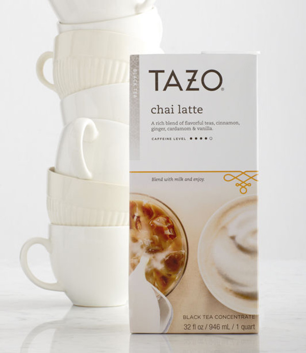 stacked white coffees cups and a box of Tazo chai latte