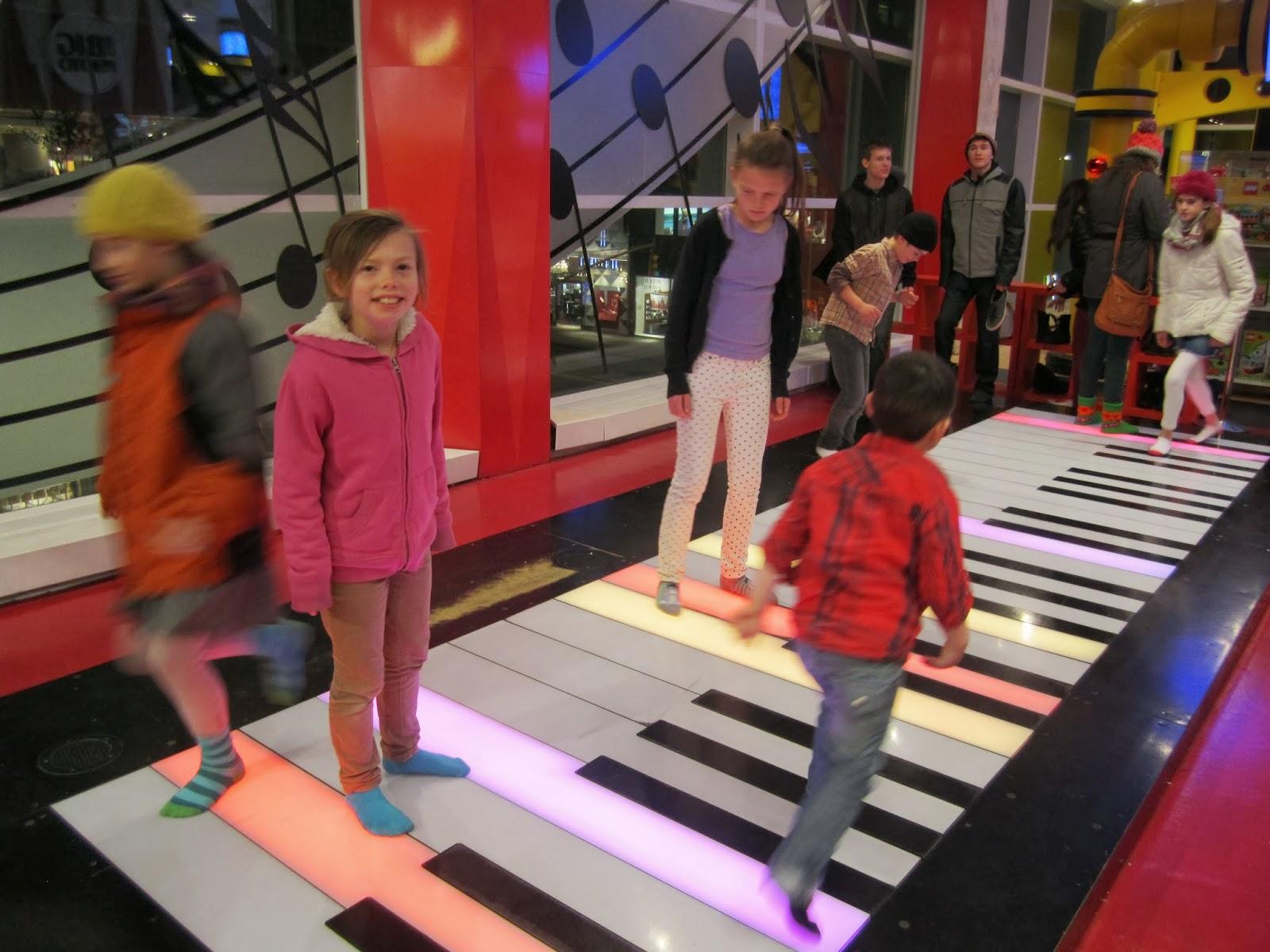 big piano, fao schwartz, kids smiling