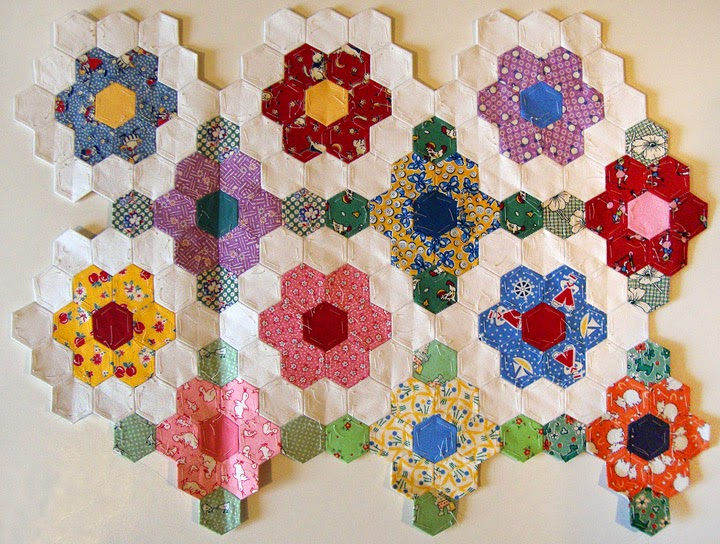 Grandmothers Flower Garden hexie quilt, Robin Atkins, flowers stitched together in small groups
