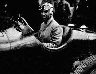 Tazio Nuvolari at the wheel of the Alfa Romeo car in  which he won the 1935 German Grand Prix