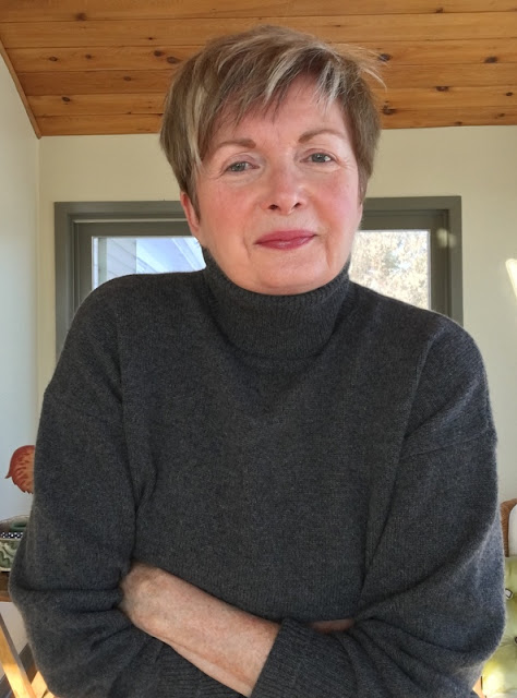 woman in grey sweater smiling