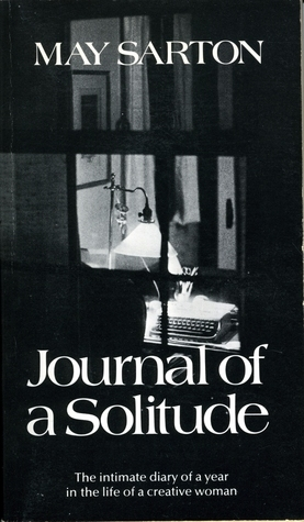 "Black and white cover of May Sarton's ""Journal of a Solitude,"" a shot of an empty desk with a typewriter, lit by a lamp from outside a window."