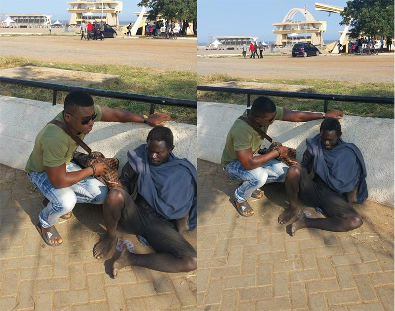 Ghanaian man consoles mad man crying of hunger, gives him money for food