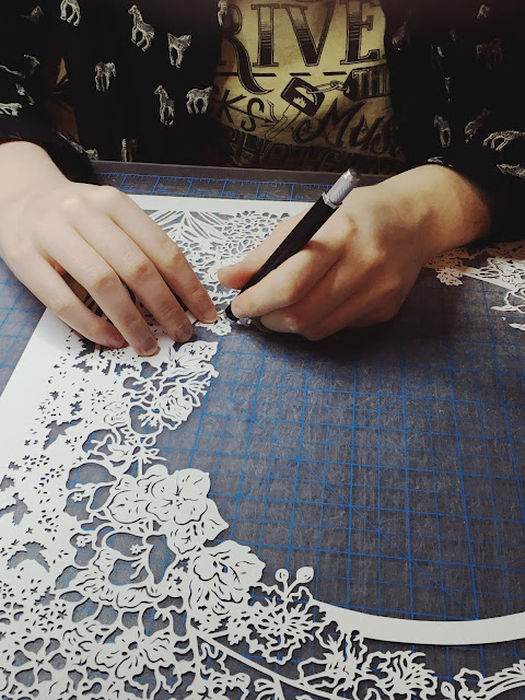 papercut artist Naomi Shiek papercutting a custom design quaker ketubah