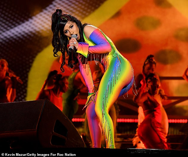 Cardi B Flaunts her sexy curves in a rainbow catsuit as she twerks at the America Festival (Photos)-olowublog