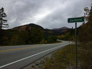 View of the Garfield highway sign with the fall colors on the mountains