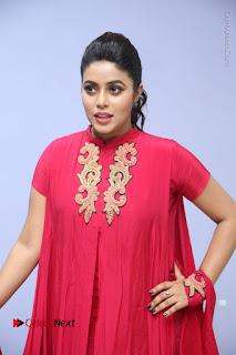 Actress Poorna Latest Stills in Red Dress at Rakshasi First Look Launch  0237.JPG
