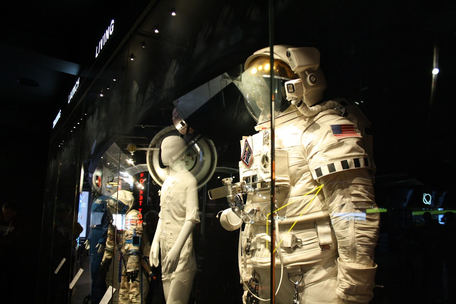 various space suits worn by mannequins in National Space Centre displays