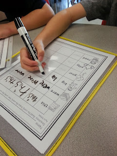 Using dry erase pockets for paper-saving center activities- a new staple in the classroom to save paper and engage students