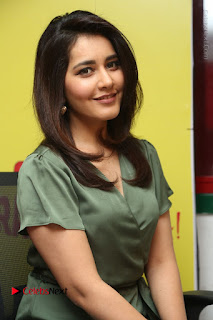 Actress Raashi Khanna Stills in Green Short Dress at Mirchi 95 Suno Aur Mercedes Jeeto Contest  0117.JPG