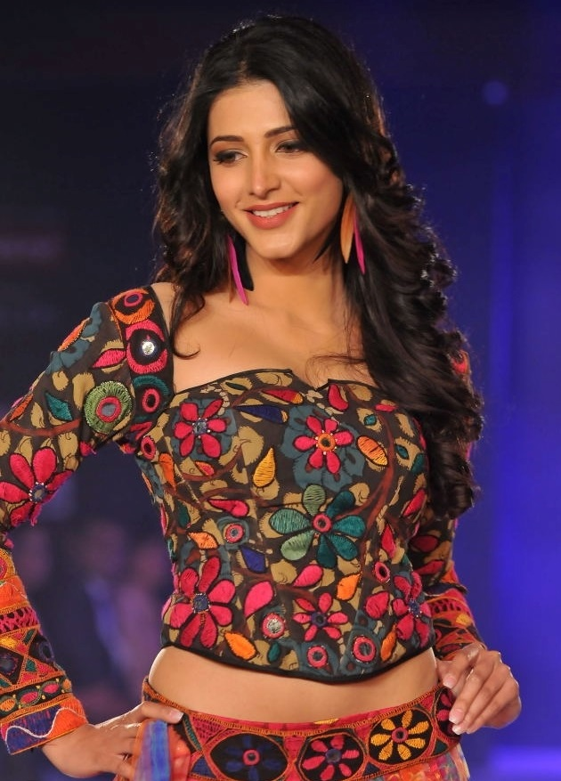 Shruti Haasan At International Fashion Week In Orange Dress