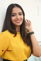 Actress Poojitha Stills in Yellow Short Dress at Darshakudu Movie Teaser Launch .COM 0161.JPG