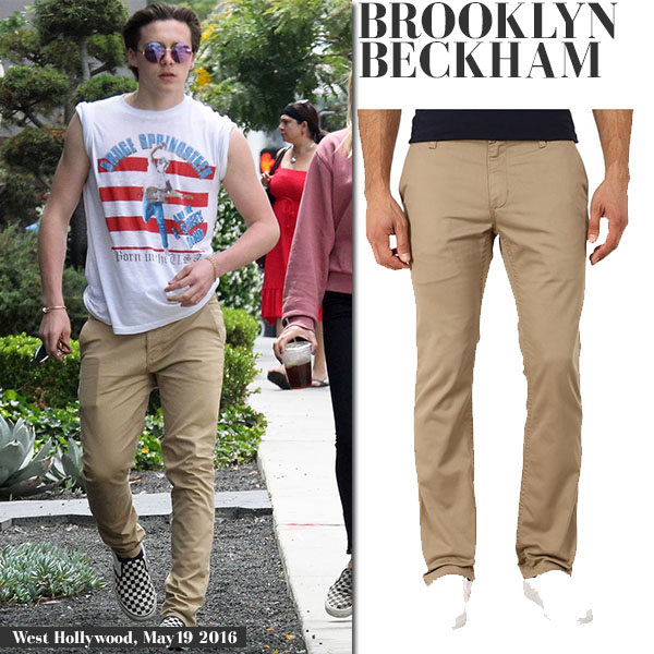 Brooklyn Beckham in Bruce Springsteen t-shirt and khaki chino pants Vans casual everyday fashion