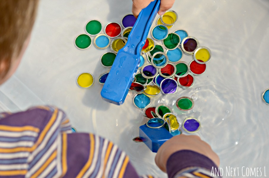 Colorful sensory bin play for kids using water and magnets from And Next Comes L