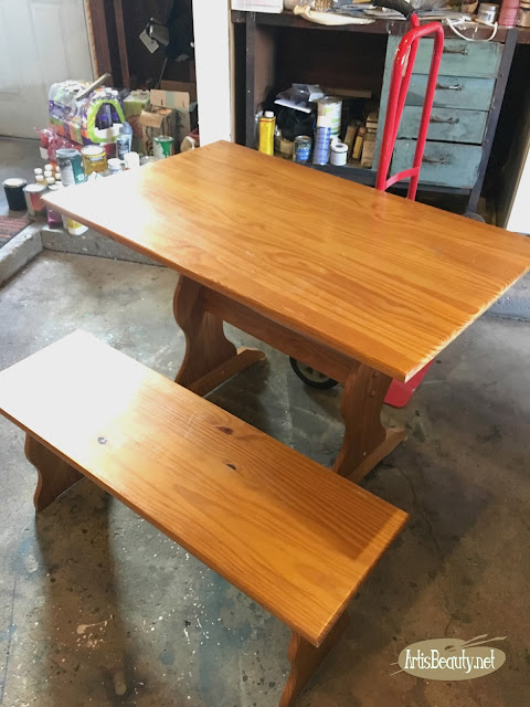 beat up old farmhouse table before update with general finishes gel stain and paint