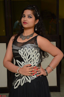 Shrisha Dasari in Sleeveless Short Black Dress At Follow Follow U Audio Launch 050.JPG