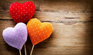 colorful hearts with wooden background