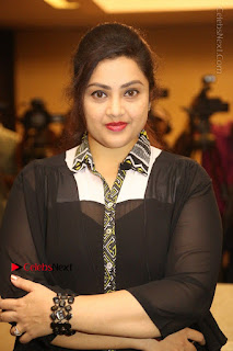Tamil Actress Meena Latest Stills in Black Dress at TSR TV9 Awards Press Meet  0064.JPG