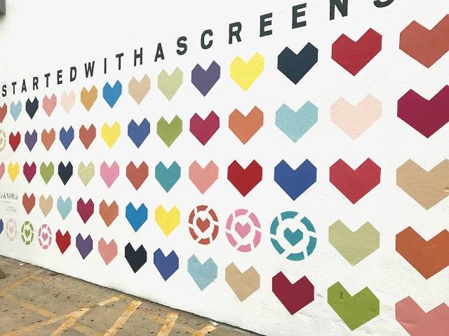LIKEtoKNOW.it mural - aka the #StartedWithAScreenshot He(art) Wall - on the east-facing wall outside of The Standard Pour in Uptown Dallas -  2900 McKinney Ave., Dallas