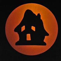 Vintage-style art lanterns, books, and postcards for Halloween by artist Bindlegrim.