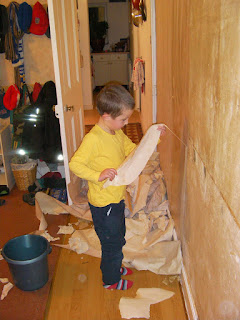 boy stripping wallpaper home redecoration
