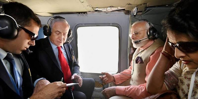Image Attribute: Indian Prime Minister Modi and Israeli Prime Minister Netanyahu in a Helicopter, on the way to Haifa in Israel / Source: PTI Twitter Feed