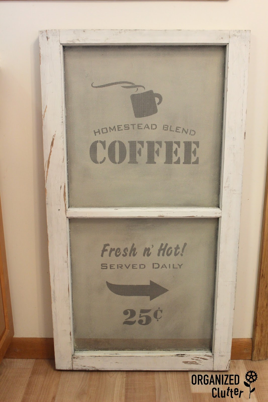 A Stenciled Window Screen With Old Sign Stencils