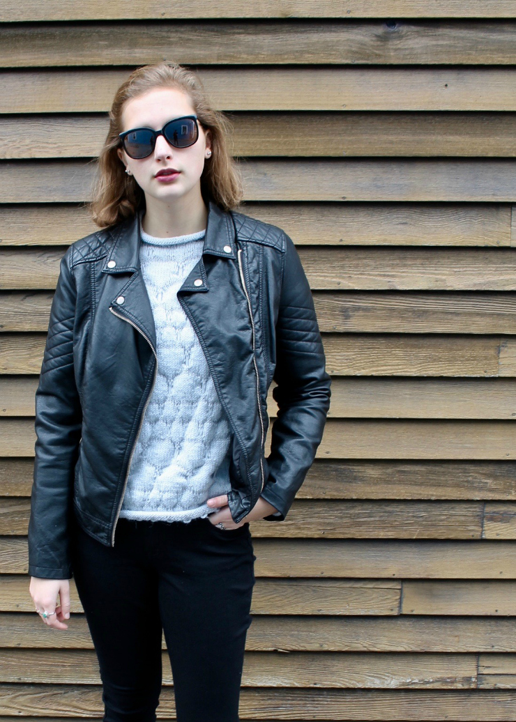 leather jacket, hand knit sweater, black skinny jeans and white trainers