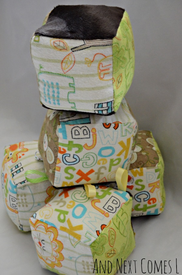 Homemade baby gift idea: fabric blocks for baby that rattle and jingle from And Next Comes L
