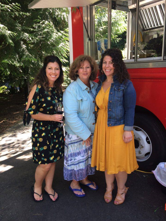 Maria, Anita, and Elizabeth pose outside of Jimmy Vs Food Truck Catering their Celebration