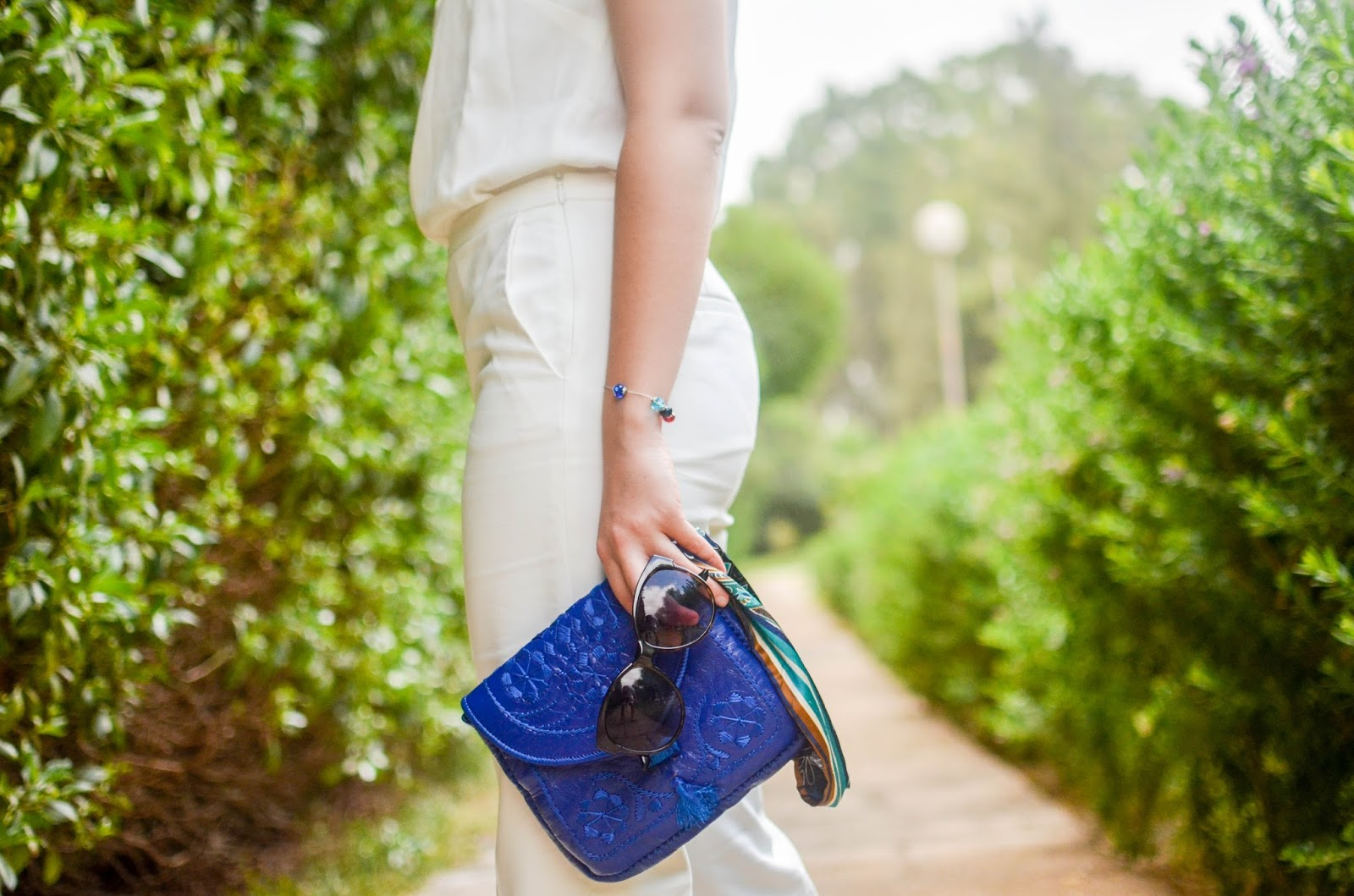 stylish monochrome look and blue moroccan clutch