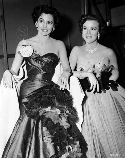 "Cyd Charisse as Gabrielle Gerard backstage with Nanette Fabray  as Lily Marton in formals designed by Mary Ann Nyberg   1953 ""The Band Wagon"""