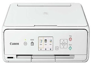 The Canon PIXMA TS5020 house photo computer printer
