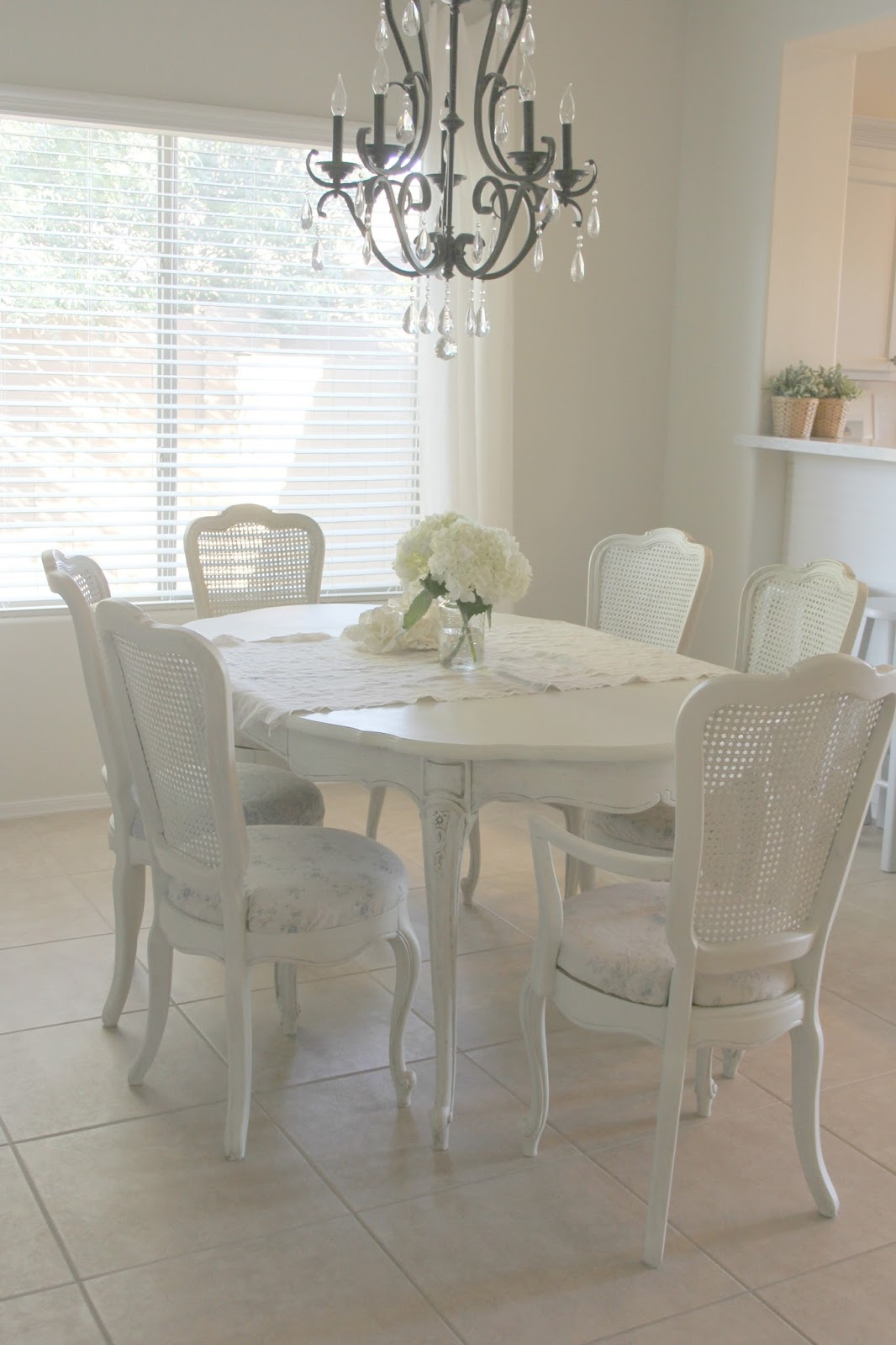 Beautiful shabby chic style dining set with linen covered chairs by Hello Lovely Studio