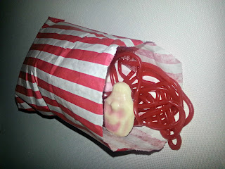 Bag of red liquorice bootlaces and skull sweets